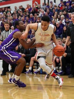 Oak Hills guard Ryan Batte drives to the basket past Elder guard Dashawn Mosley.