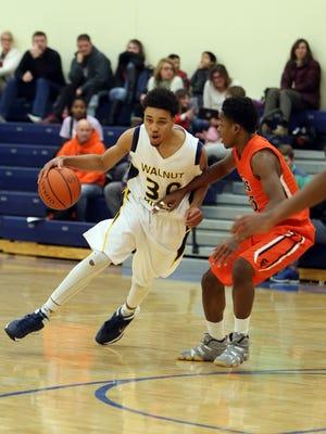 Walnut Hills guard Omari Peek drives to the basket against Anderson.