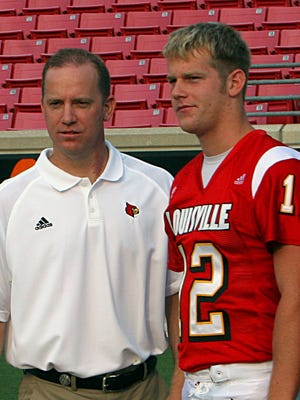 Jeff Brohm, left, quarterbacks coach at the University of Louisville, and his brother, Brian, sophomore quarterback, are shown at Papa John's Cardinal Stadium in Louisville, Ky., Saturday, Aug. 6, 2005.