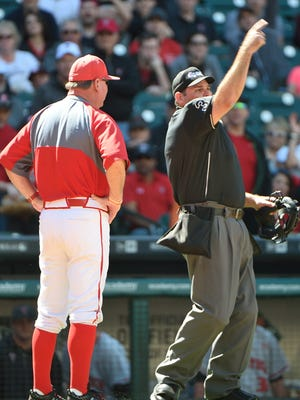 Umpire Myron Miller throws Cajun's coach Tony Robicheaux ou tof the game during the Shriner Houston College Classic Saturday, February 27, 2016 Chris Daigle special to the Advertiser