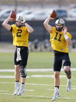Quarterbacks Elijah Sindelar, background left, and David Blough during spring football practice Tuesday, March 8, 2016, at Purdue University.