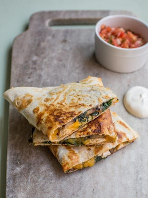 Spinach, mushroom, and chicken quesadillas is from a recipe by Katie Workman.