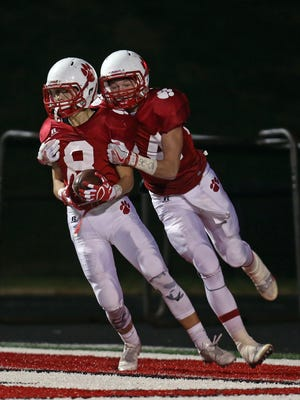 Beechwood WR Daniel Mescher [8] is congratulated by teammate Garrett Ratliff after scoring a TD in the KHSAA football playoff game between the Russellville Panthers and the Beechwood Tigers at Beechwood High School.