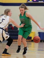 Bridgette Grote of Seton dribbles around her back to