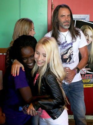 Makayla Smith,13, is greeted by 13-year-old Recording Artist Vivian Hicks (right) during a fundraiser at Fuzzy's Taco Shop on Oct. 22. Hicks will be part of an anti-bullying roundup in the Wichita Falls ISD middle schools.