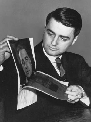 Edwin H. Land, founder of the Polaroid Corp., peels apart a Polaroid photo of himself in 1947 in Cambridge, Mass.