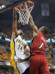 Pacers Paul George drive and dunk on Miami's Chris Bosh in the first half of their game #6. Indiana Pacers play the Miami Heat in game #6 of the Eastern Conference Finals Saturday, June 1, 2013, evening at Bankers Life Fieldhouse. Matt Kryger / The Star