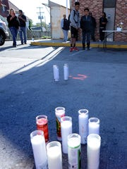 Candles were on display during a vigil for Exxon employee