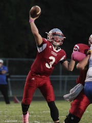 Bethel-Tate quarterback Seth Becker throws over the