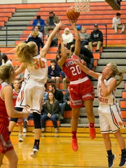 Ravenwood's Jazmyn Harmon drives in for the lay up