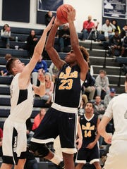 Yusef Williams of Walnut Hills goes hard to the net.  The West Clermont Wolves lost a close home opener game to the Walnut Hills Eagles.