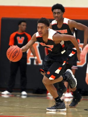 Withrow guard John Lawrence starts a fast break in the game between the Withrow Tigers and the Anderson Redskins at Anderson High School.