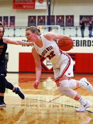 Lakota West forward Abby Prohaska drives to the basket in the game against  McAuley. Lakota West won  53-48.