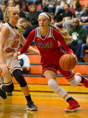 Page's Faith Wilken drives against Dickson County's Sierra Morgan. Wilken was the leading scorer for the night with 30 points.