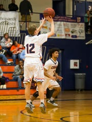 Dickson County's Noah Edmisson shoots from 3 point