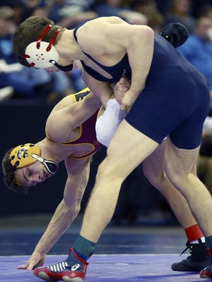 Brookfield Academy's Aidan Medora wrestles  Nathan Ronsman of Luxemburg-Casco in a 132-pound Division 2 quarterfinal Friday at the Kohl Center.