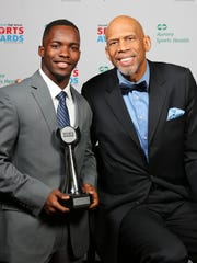 Hartford High School's Richard Smith, the 2018 winner of the Journal Sentinel's I AM SPORT award, poses with guest speaker Kareem Abdul-Jabbar.