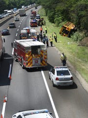A school bus carrying 21 children and four adults ran off the New Jersey Turnpike just south of Haddonfield-Berlin Road in Cherry Hill on Friday. Sixteen children received minor injuries.