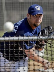 Milwaukee Brewers pitcher Brooks Kieschnick throws a pitch spring training in 2005.