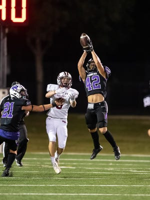 Cedar Ridge defender Justin Higginbotham jumps in front of Mason Schuler for an interception in the Raiders' win over Round Rock earlier this season. Cedar Ridge makes its debut in the Statesman's Class 6A poll this week