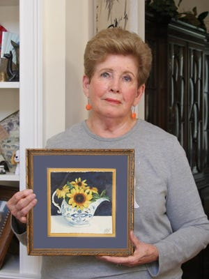 "Helen McKenney shows her watercolor ""Daisies in Blue Danube."""
