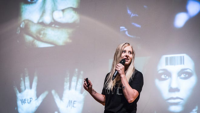 Sex-trafficking survivor Lexie Smith speaks to Central students about the signs someone is being trafficked.