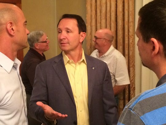 Attorney General Jeff Landry speaks with API members after Monday's meeting.