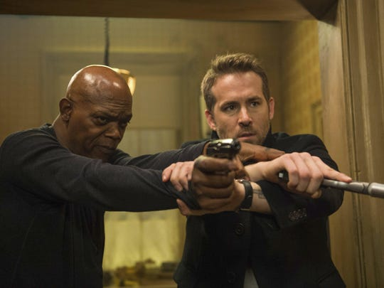 "Samuel L. Jackson, left, and Ryan Reynolds in ""The Hitman's Bodyguard."""