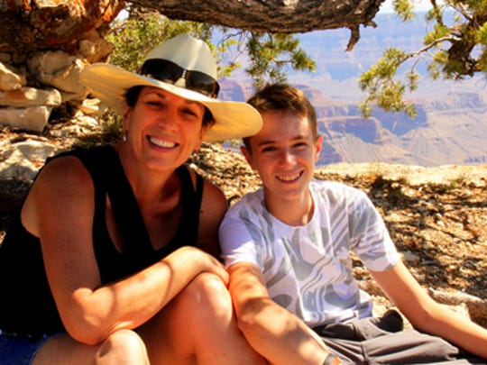 Karina Bland with her son, Sawyer, hiking on the edge of the Grand Canyon's North Rim in summer 2011. Credit: Lesley Hooser.