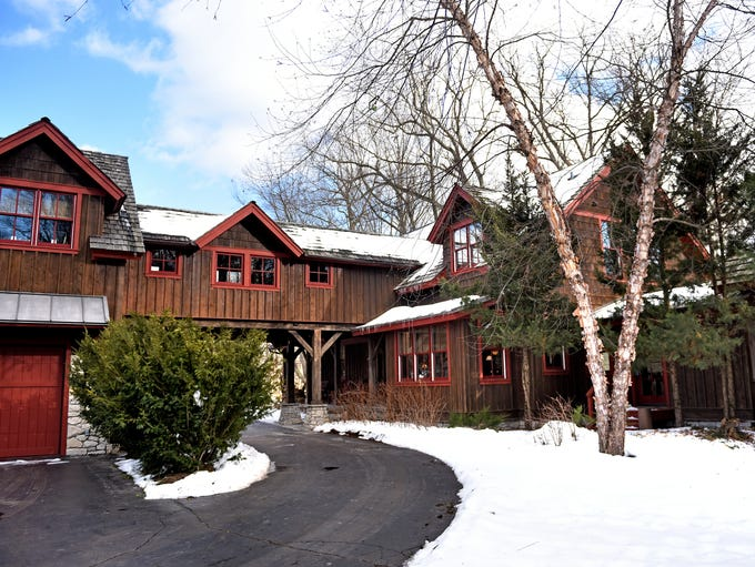 A timber-frame home near Williamston features a bridge