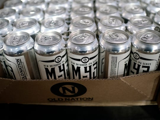 Can of Old Nation Brewing Company's M-43 beer set in the cooler waiting to be distributed on Wednesday, Feb. 28, 2018, in Williamston.