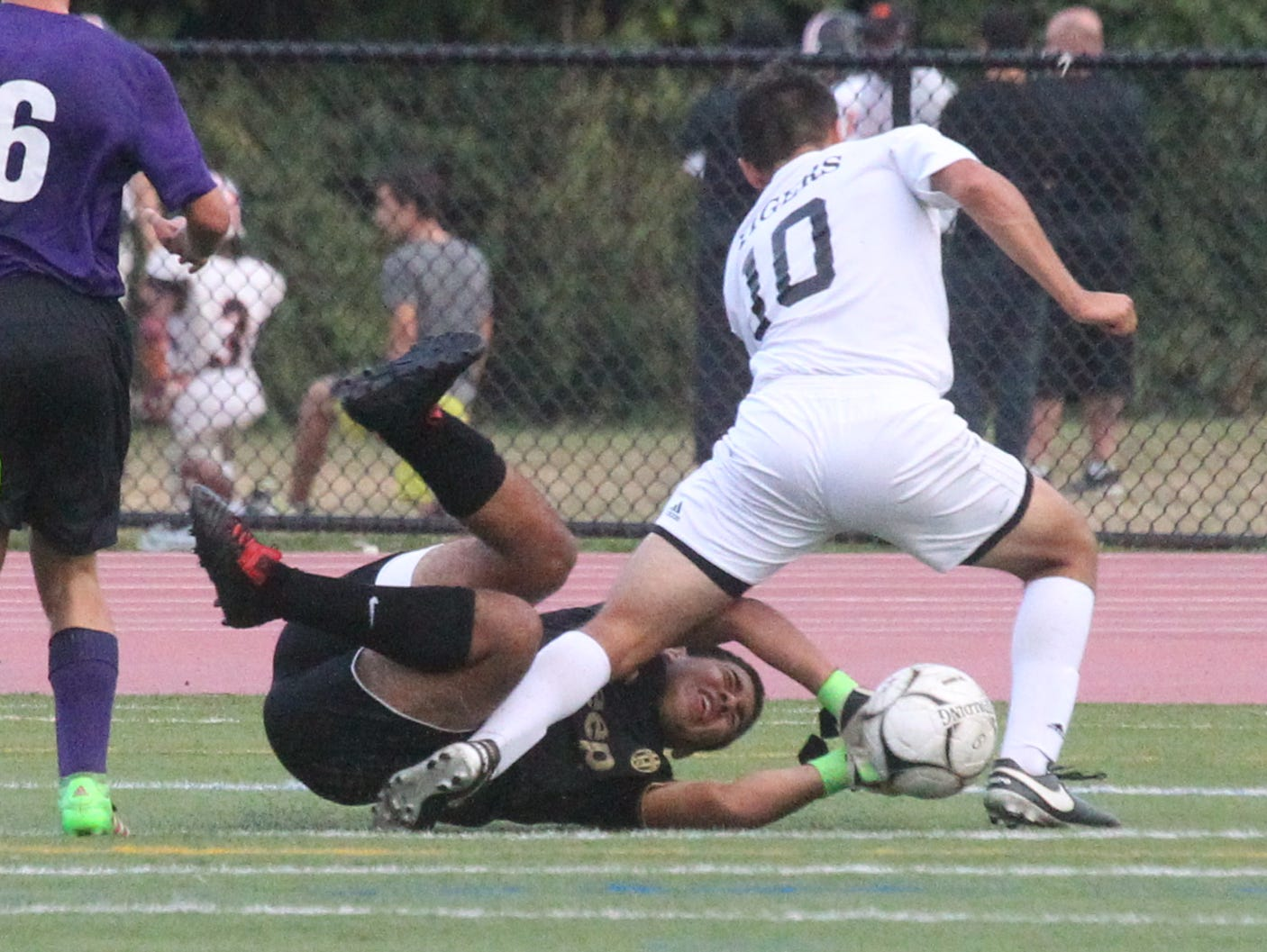 New Rochelle goalie Danny Ayala stops White Plains' Alessandro Battaglia during their game at White Plains Sept. 26, 2016. New Rochelle won 2-0.