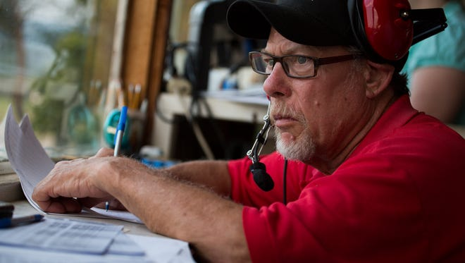 Keith Trenary, the official scorer at Eastside Speedway, keeps an eye on the track as racers compete on Saturday, July 25, 2015.