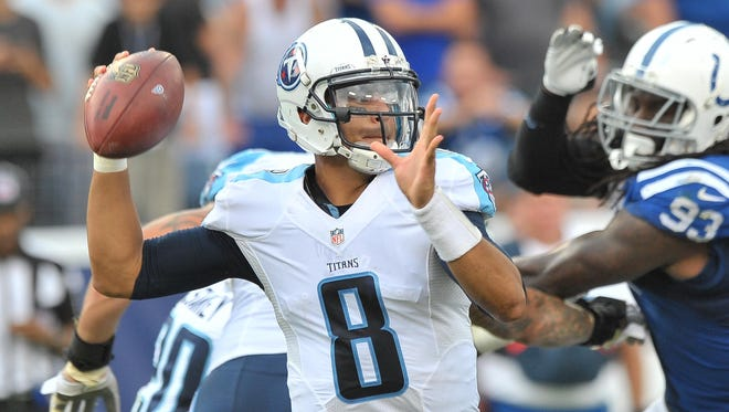Sep 27, 2015; Nashville, TN, USA; Tennessee Titans quarterback Marcus Mariota (8) passes against the Indianapolis Colts during the second half at Nissan Stadium. Indianapolis won 35-33. Mandatory Credit: Jim Brown-USA TODAY Sports