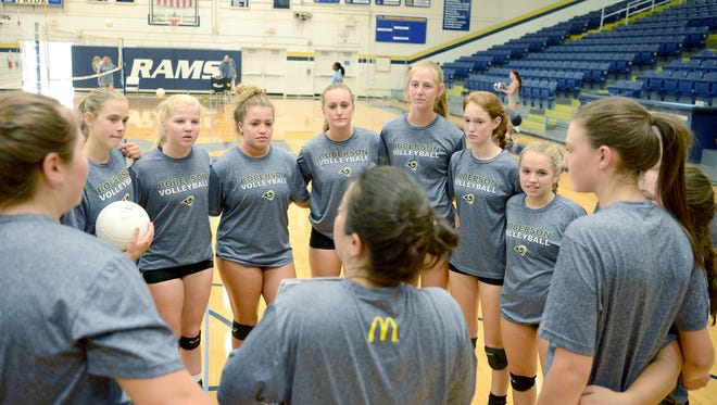 The Roberson volleyball team huddles up during Tuesday's practice in Skyland.