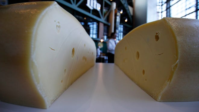 In this March 7, 2017, file photo, a freshly cut wheel of swiss cheese sits at the U.S. Championship Cheese Contest in Green Bay, Wis. The Wisconsin Legislature agreed Tuesday, May 2, to designate cheese as the official dairy product of Wisconsin, which produces more 3 billion pounds of cheese per year, more than any other state.
