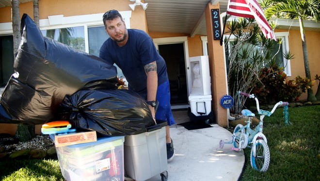 Brad Shows moves household items and supplies to his trailer as he complies with a mandatory evacuation as residents and visitors in Florida prepare ahead of Hurricane Irma on Sept. 09, 2017 in St. Petersburg, Fla.
