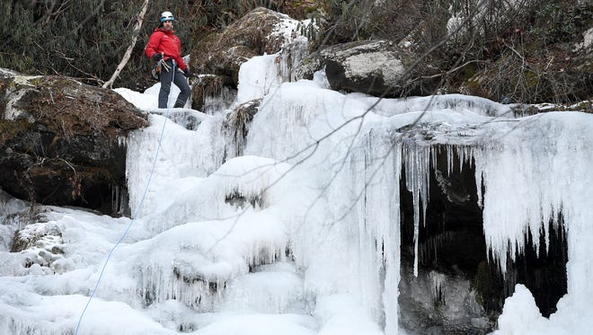 "Anthony D'Ercole, an instructor with Fox Mountain Guides, waits atop a section of Catawba Falls in Old Fort as he ice climbs on Friday, Jan. 5, 2018. ""It's kind of you versus whatever Mother Nature gave you,"" he said of the sport."