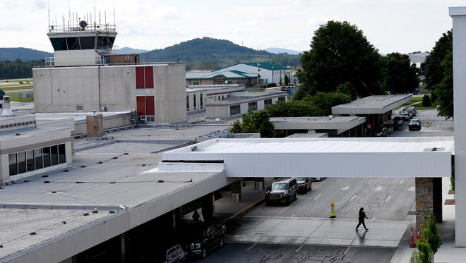 A woman walks to the parking deck at the Asheville Regional Airport on Tuesday, June 12, 2018.