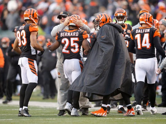 Cincinnati Bengals running back Giovani Bernard (25) is met with celebration as he returns to the sideline after his touchdown run in the fourth quarter of the NFL Week 15 game between the Cincinnati Bengals and the Detroit Lions at Paul Brown Stadium in downtown Cincinnati on Sunday, Dec. 24, 2017. The Bengals took a 26-17 win over the Lions in the final home game of the season.