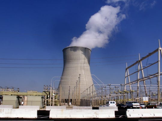 Natural draft cooling tower of Salem nuclear reactor stands behind concrete barriers in Lower Alloways Creek Township, N.J. on Wednesday Oct. 3, 2001.