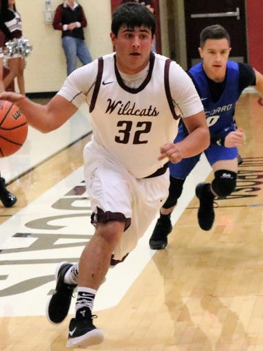 Tularosa's Toby Carrillo brings a ball down the court.