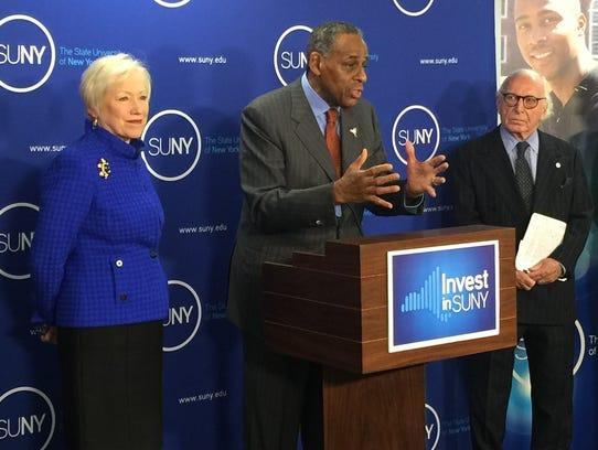 SUNY chairman Carl McCall speaks alongside Chancellor