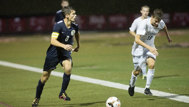 Roberson's Garrett Douglas (6) looks to make a pass in Monday's 1-0 win at Asheville High.