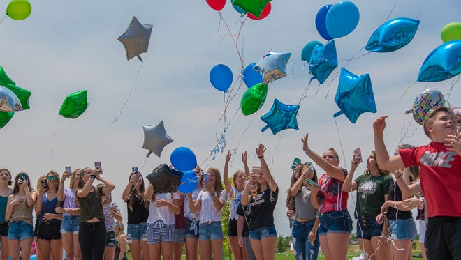 Family and friends release balloons as part of a memorial service for 13-year-old Gavin Myers  on July 2 in Loveland.