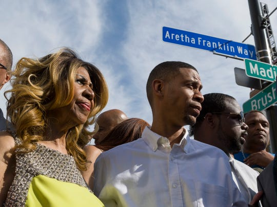 Singer Aretha Franklin and her son, Kecalf Cunningham, stand under Aretha Franklin Way, a street renamed in her honor, in Detroit, June 8, 2017. A portion of Madison Street near Comerica Park will have both names.