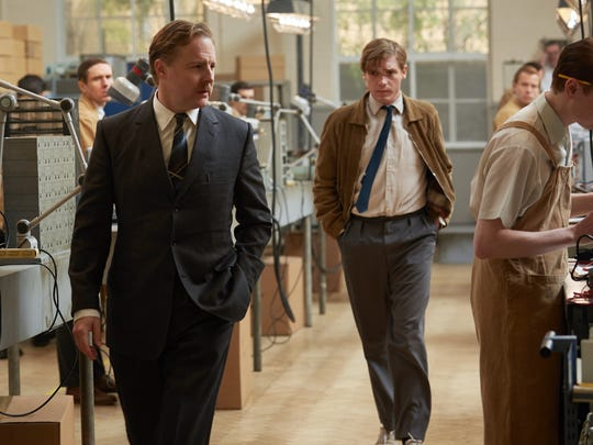"""Geoffrey (Samuel West, left) and his son-in-law (Billy Howle) walk through his factory in """"On Chesil Beach."""""""