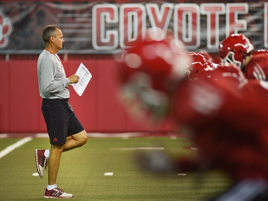 USD head coach Bob Nielson during practice after media
