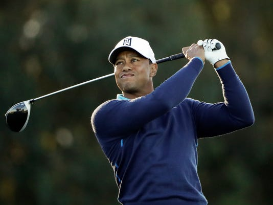 Tiger Woods watches his tee shot on the sixth hole of the north course at Torrey Pines Golf Course during the pro-am event at the Farmers Insurance Open golf tournament, Wednesday, Jan. 24, 2018, in San Diego. (AP Photo/Gregory Bull)