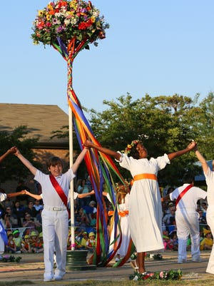 Thomas Greener, left, of Jackson and Madison Cox, right, of Ridgeland wrapped the maypole with their classmates at the end of their 4th grade year at St. Andrew's during the 2016 May Pole celebration.
